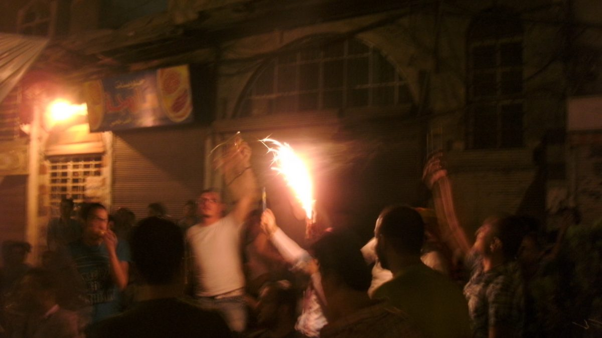 Fireworks and celebration in the street at night