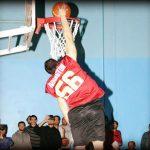 Man scoring basketball shot