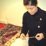 Woman making carpet