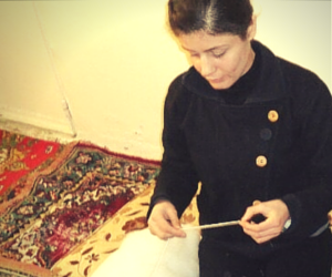 Woman making carpet