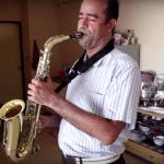 Man playing saxophone at home