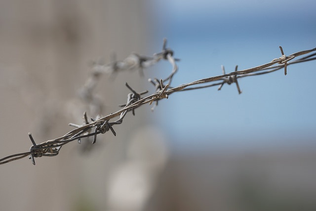 Close up of barbed wire by Charles Roffey Creative Commons