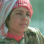 Woman in red and white headscarf