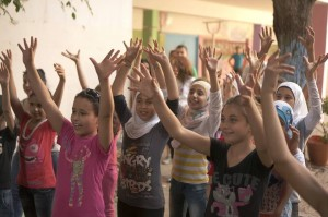 Syrian girls with their hands in the air