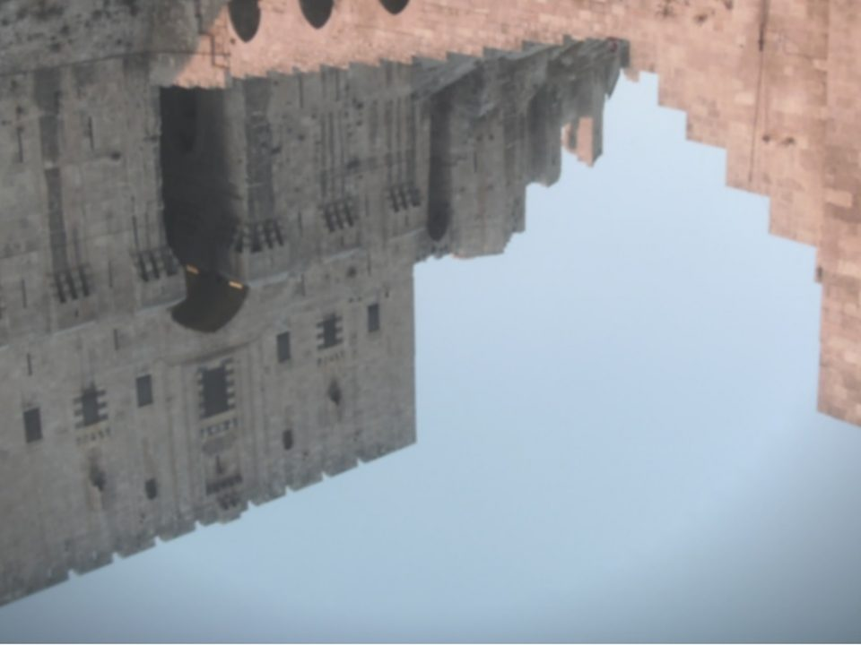 Reflection of Aleppo buildings in water