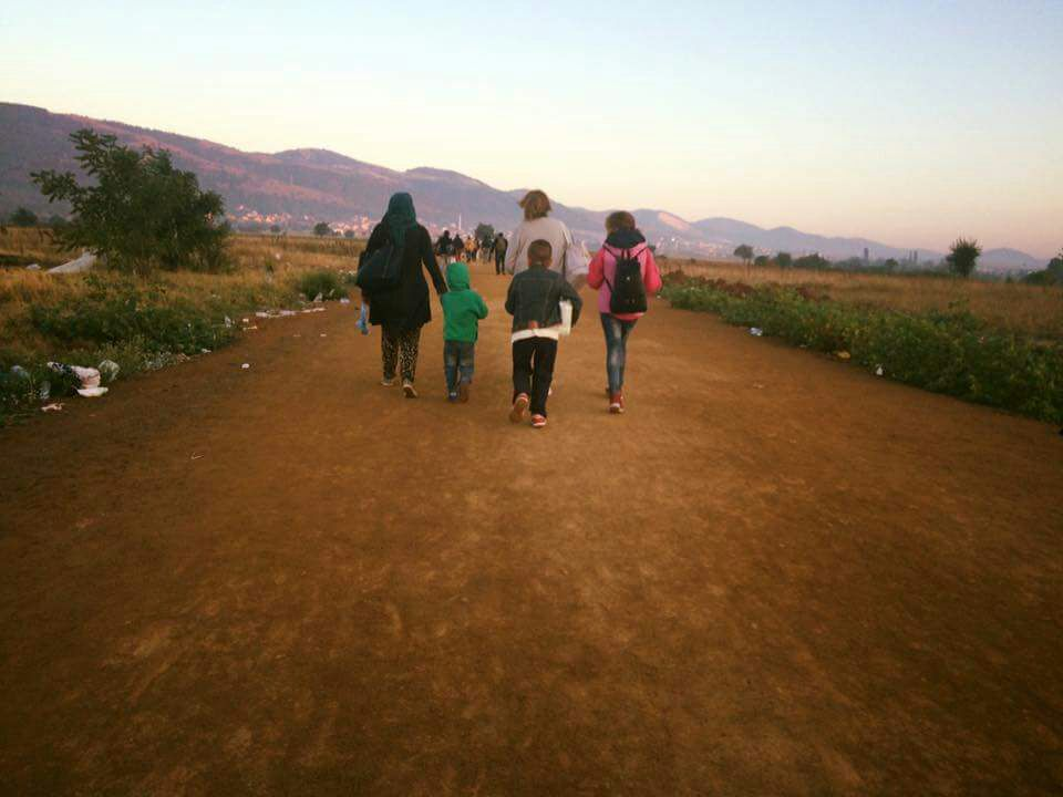 Family group walking on dust path
