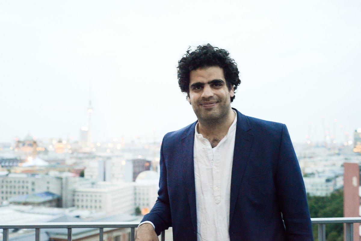 Ahmed Katlish standing on balcony