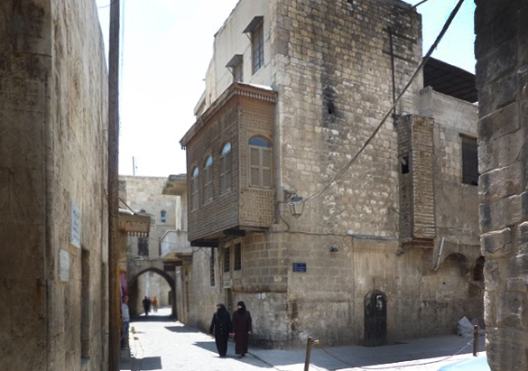 Street in Aleppo with two women