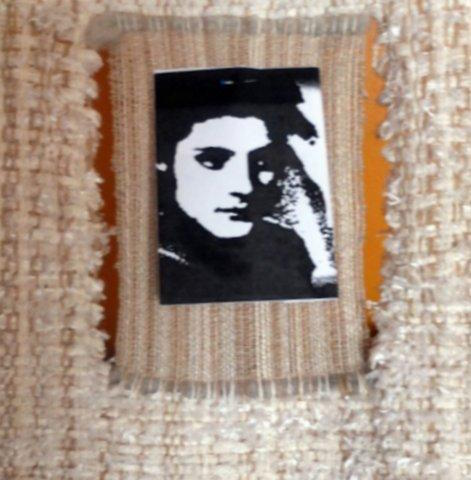 Weaving incorporating photograph of woman