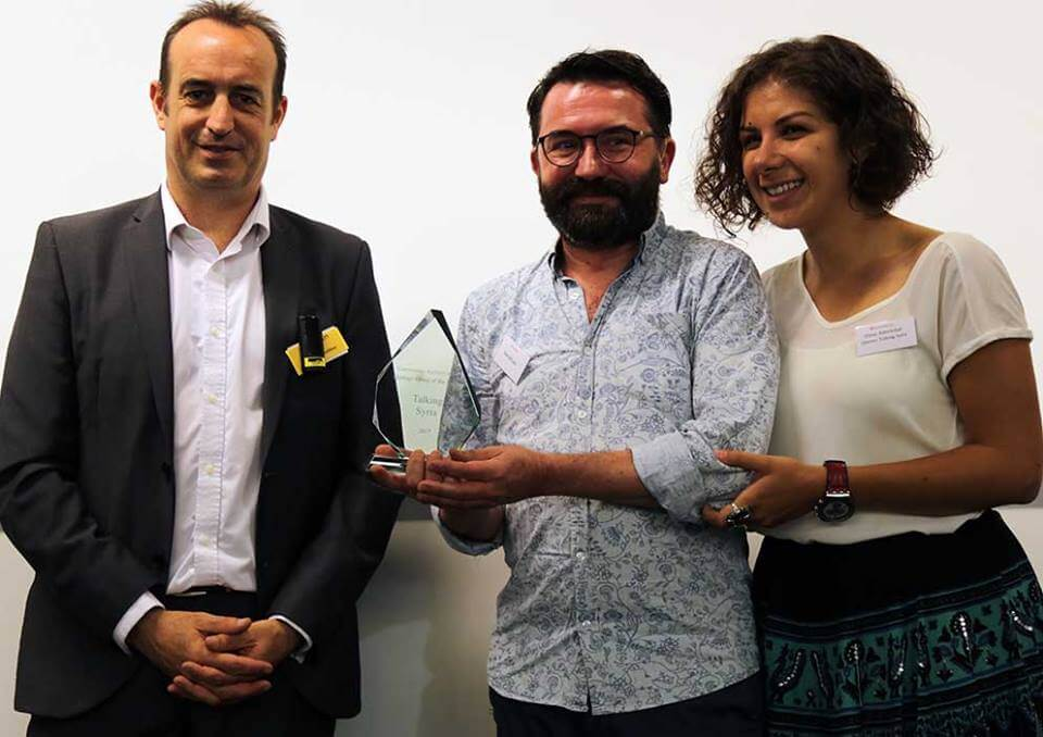 Qisetna's Juan delGado and Dima Mekdad collect award from Community Heritage and Archives Group