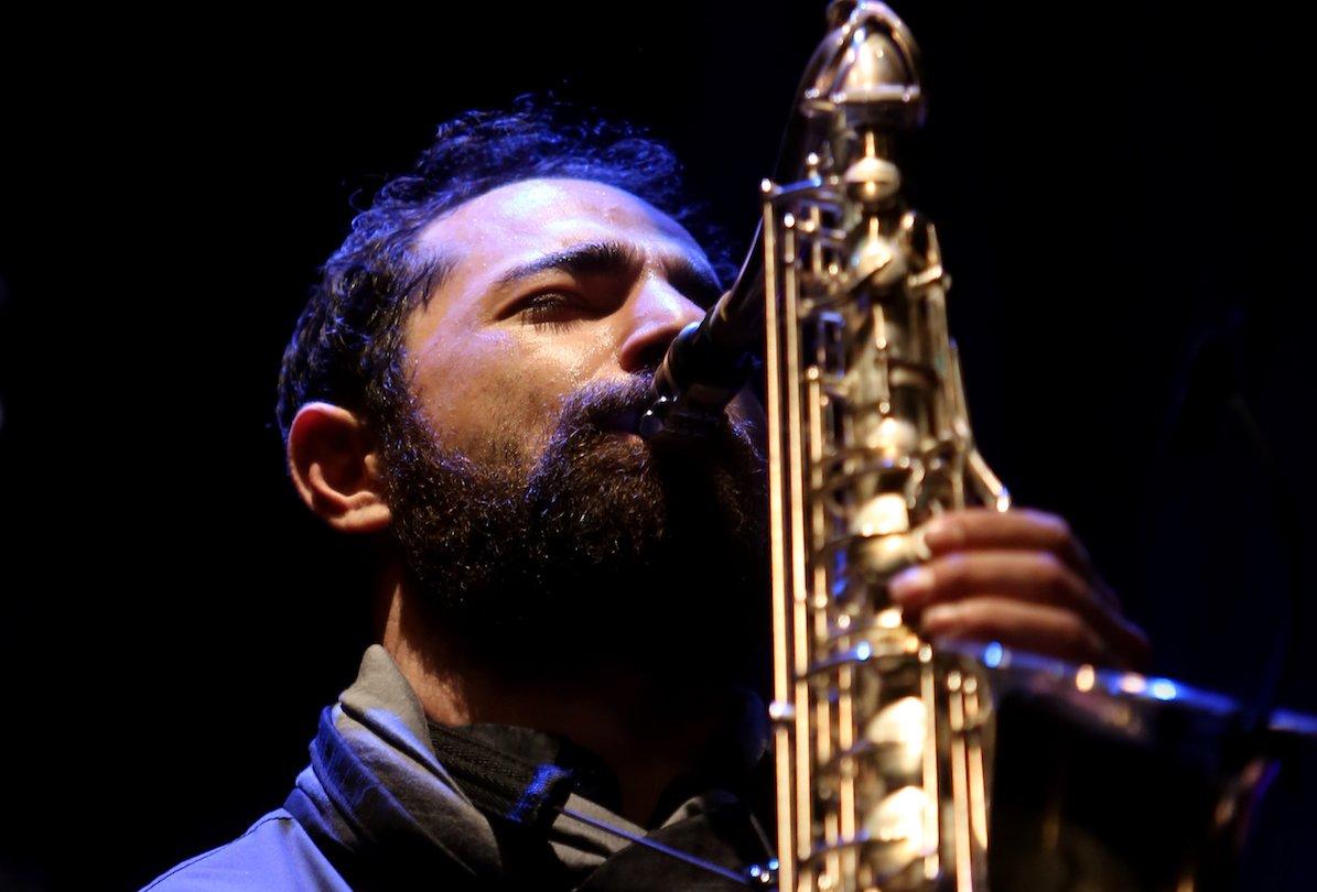 Basel Rajoub playing saxophone