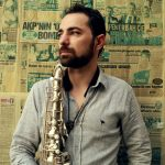 Basel Rajoub holding saxophone