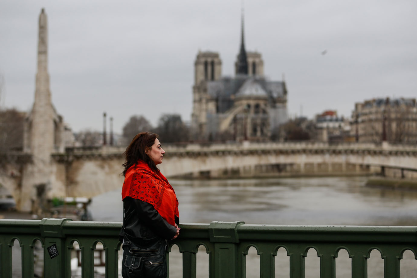 Maha Hassan standing on bridge in Paris