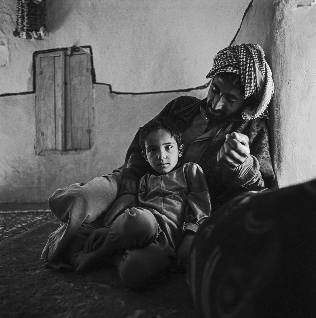 This image has an empty alt attribute; its file name is Kevin-Bubriski-Father-and-son-North-of-Aleppo-Syria-2003.jpg